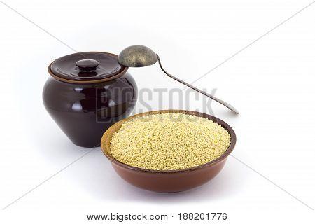 Dry Millet In Ceramic Bowl Isolated On White. Spilled Millet.