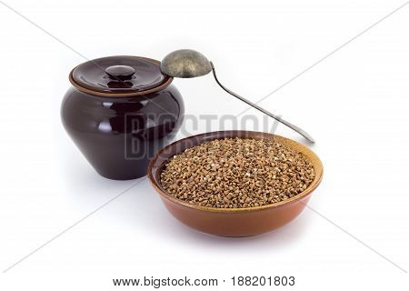 The Composition Of The Buckwheat Groats In A Clay Pial Next To A Clay Pot And A Copper Spoon,