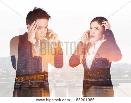 Double Exposure Of Worried Businessman And Businesswoman Talking On Smartphone With City Background