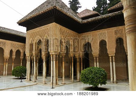 Granada, Spain - February 10, 2015: An Archway To Court Of The Lions With Fountain At Alhambra Palac