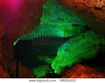 Underground cave with colored lights on the walls