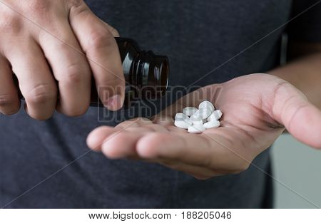 Man Hand Holding Frug Medicine Bottle On Herbal Supplement Pill,eating Healthy