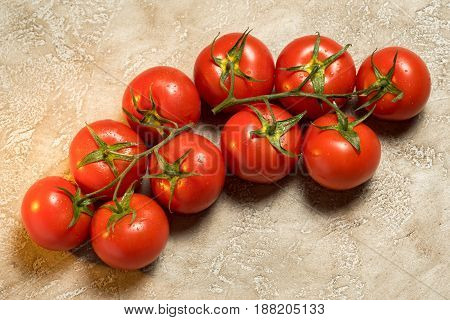 Bunch Of Red Ripe Tomatoes On The Table With Copy Space