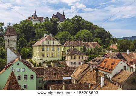 Medieval citadel on the hill above the old Lower Town of Sighisoara city Romania one of the most beautiful and best-preserved medieval towns in Europe a World Heritage Site by UNESCO.