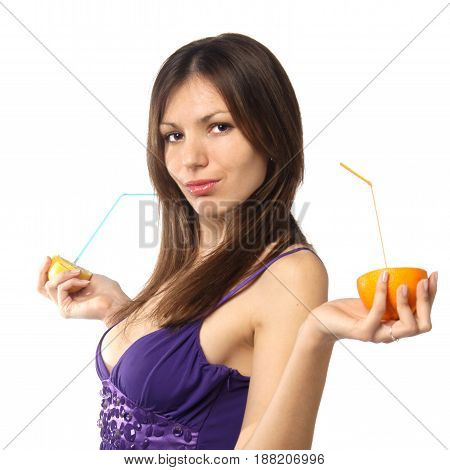 studio portrait of young attractive woman with fresh citrus isolated against white background