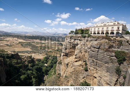 Cliffs under Ronda town, Malaga, Andalusia, Spain. The Guadalevin River runs through the city dividing it in two and carving out the steep 100 plus meters deep El Tajo canyon upon which the city perches