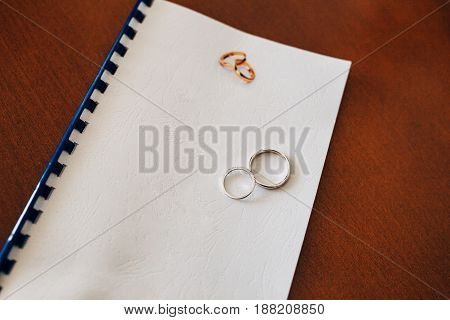 Wedding rings of the newlyweds. Engagement gold rings. Wedding in Montenegro.