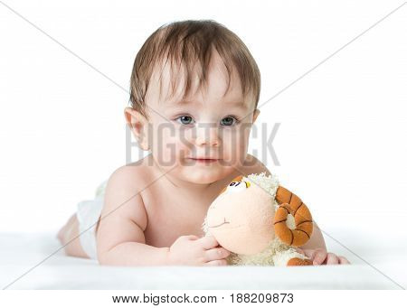 baby boy lying on his tummy with plush toy