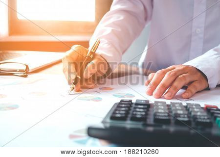Businessman's Hands With Calculator Counting Making Notes At Home