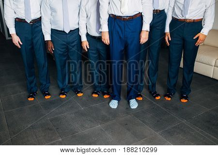 Male feet close-up. Feet grooms at a wedding in Montenegro.