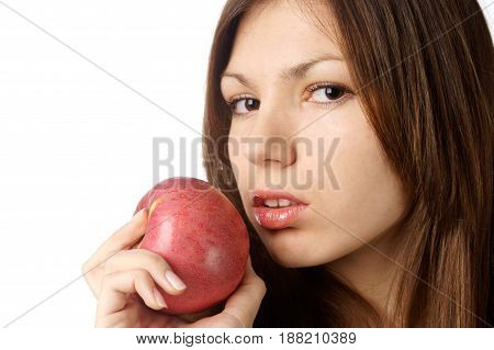 studio portrait of attractive young woman with red apple against white background