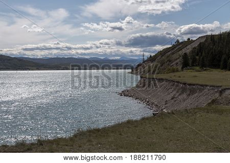 A vertical shot of the shoreline of Ghost Lake in Alberta Canada.
