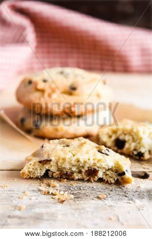 Homemade chocolate chip cookies on a wooden table, selective focus