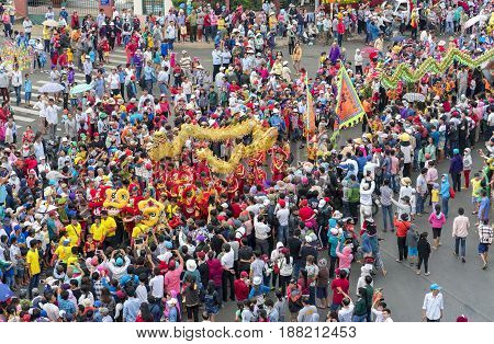 Binh Duong, Vietnam - February 11th, 2017: Chinese Lantern Festival with colorful dragons, lion, flags, cars, marched in streets attracted crowd. This traditional festivals ethnic Chinese in Vietnam