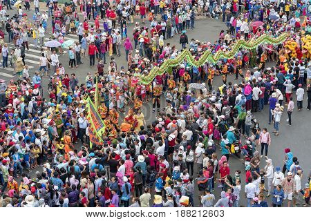 Binh Duong, Vietnam - February 11th, 2017: Festival Chinese Lantern with colorful dragons marched show in streets attracted surrounding crowd. This traditional festivals of ethnic Chinese in Vietnam