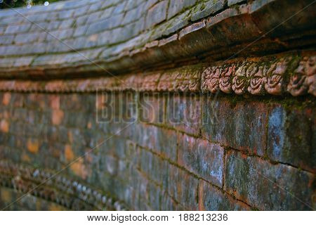 Entryway Wall Decor. Selective focus. Hindu temple. Old bricks texture. Vajrayogini Temple near Kathmandu Nepal.