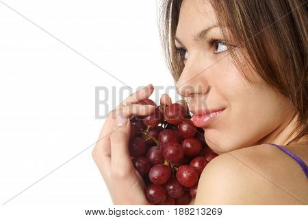 studio portrait of young beautiful woman with grape isolated on white background