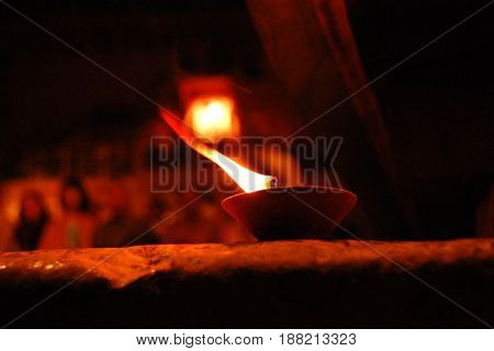 Burning candles during Varanasi Puja. Aged photo. Oil lamp enlighten. Ceremony at the River Ganga in Varanasi India.