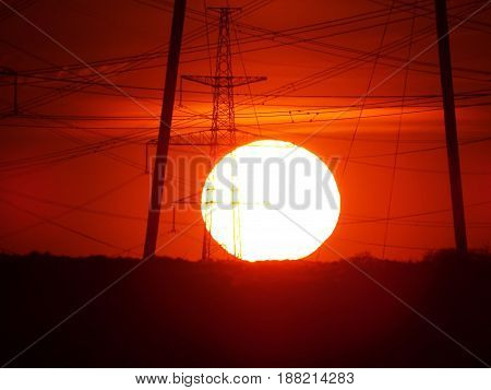 A giant sun approaches the horizon, soon this day will end