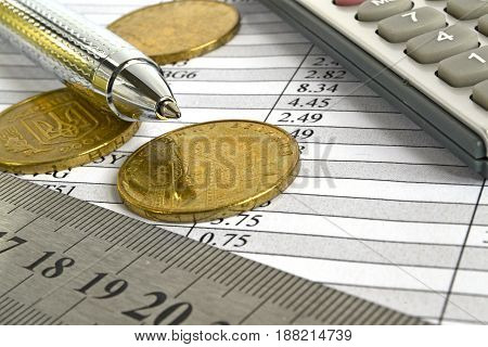 Financial background with money calculator table and pen.