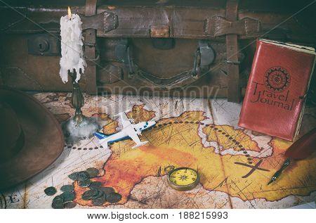 Treasure map of an adventurer and his belongings