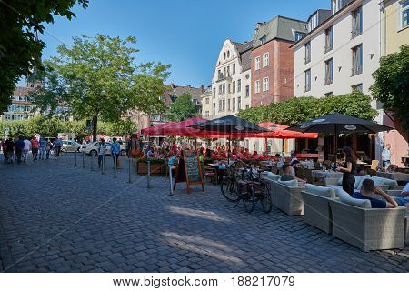 DUESSELDORF, GERMANY - AUGUST 17, 2016: Visitors populate bars and restaurants in the Altstadt and enjoy the atmosphere