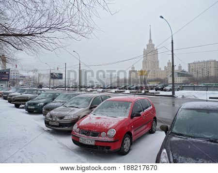 MOSCOW - RUSSIA - MARCH, 2011: View from the parking lot on  the State University named after Lomonosov on the background. The wet snowy weather, early spring.