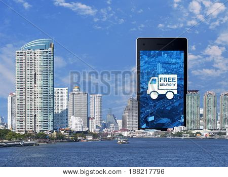 Free delivery truck icon on modern smart phone screen with modern office city tower river and blue sky Business transportation concept