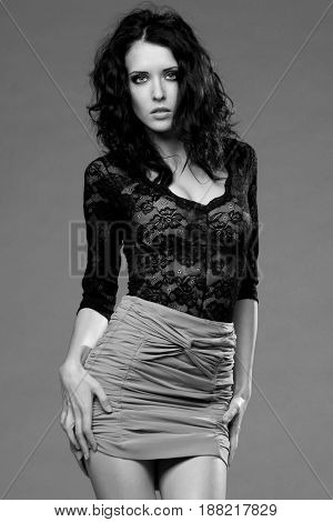studio fashion photo of young beautiful sexy female model
