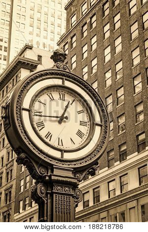 Manhattan Sidewalk Clock at 5th Avenue in New York City (USA). Edited as a vintage photo with dark edges.