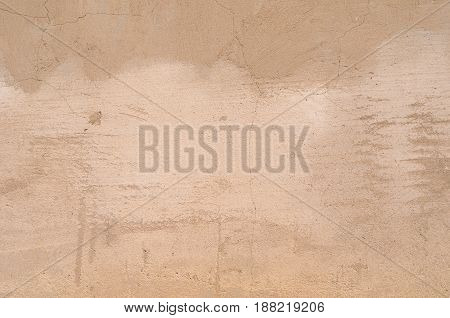 Background Of A Beige Stucco Coated And Painted Exterior, Rough Cast Of Cement And Concrete Wall Tex
