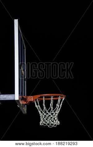 Basketball hoop isolated on black background. With copy space.