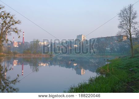 actory at river dam in sunrise with soviet building