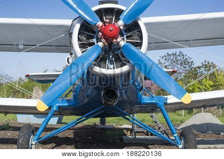 old biplane blue color front close-up view