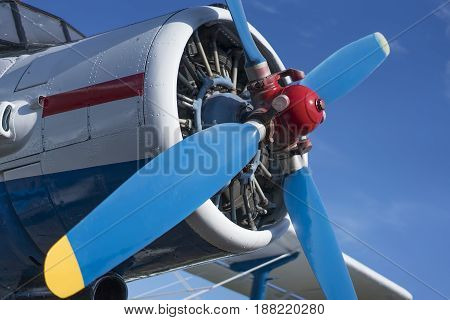 biplane propeller close-up view with blue sky background