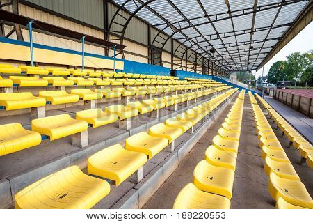 row of plastic chairs that disappear into the distance