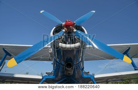 airplane propeller with engine front view on blue sky
