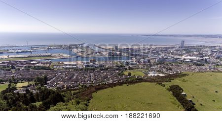 Editorial SWANSEA, UK - MAY 26, 2017: Swansea city east shot from Kilvey Hill, showing the docks, the St. Thomas area and the marina with Mumbles in the far distance.
