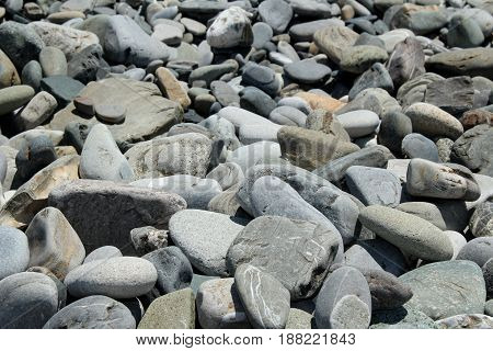 texture of grey stones that lie in heaps, close-up