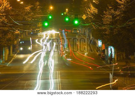 Night motion on urban streets with green traffic light
