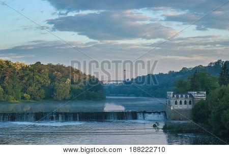 Old rusty dam in the river at dark sky