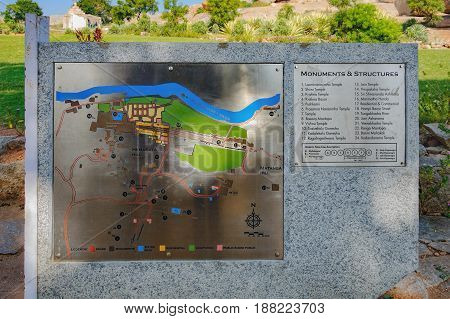 Hampi, India - November 20, 2012: Vintage sign with old map with the main ancient ruins located on the main entrance to the Hampi, India