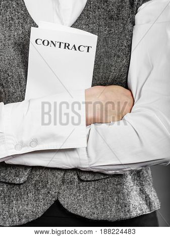Business documents legal concept - closeup serious businesswoman holding contract in hand