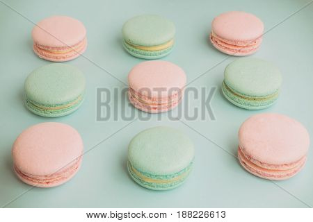 Sweet green and pink macaroons on blue background