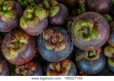 Mangosteen season for sale on market in Thailand.