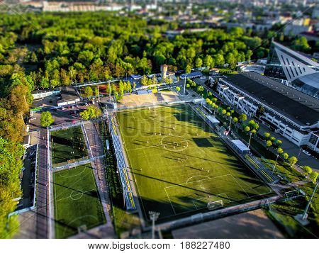 Top view from the drone to the sports grounds, football field in the city