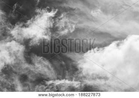 Cloudscape background of black and white dramatic monochrome cirrus and cumulus clouds