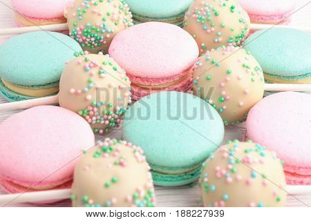 Closeup of colorful macaroons mixed with cake pops