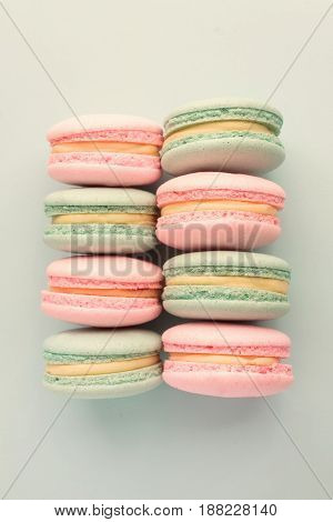 Flat lay of sweet colorful macaroons in rows. Pastel colors. Top view