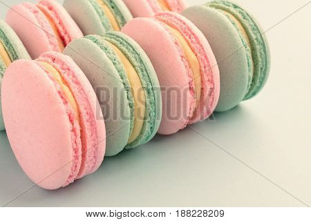 Close-up of sweet colorful macaroons with copy space